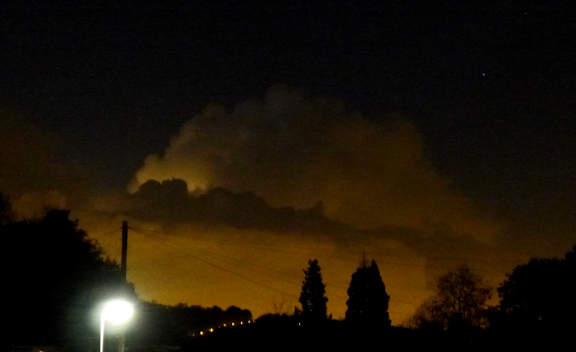 sun sets after the storm: glowing cumulonimbus over London