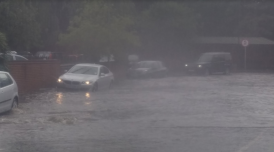 cars avoid flooded road